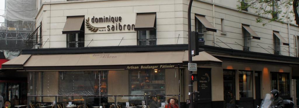 La boulangerie de Dominique Saibron et sa terrasse trônent majestueusement sur la rugissante place d'Alésia.