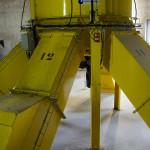 """Le silo homogénéiseur se distingue par ses multiples """"sorties"""", correspondant aux différentes sections."""