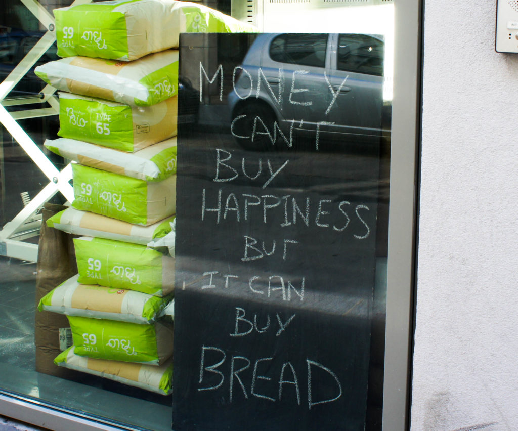 Money can't buy happiness but it can buy bread